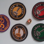 Fellsman embroidered badges £2Red - staff only; green - any; silver - veterans only; Gold - finishers only. 50th Anniversary badge (purple and gold) £1. Fellsman Logo pinbadge 20p